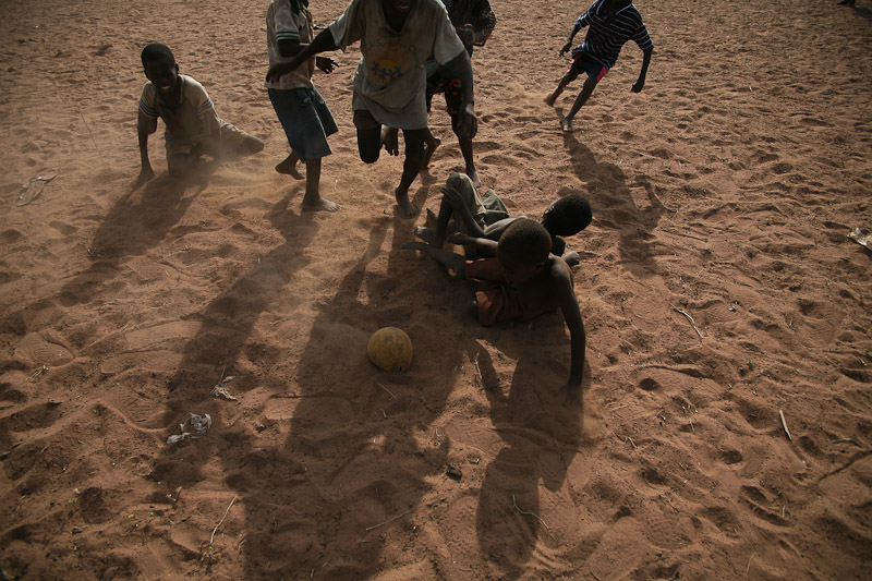 Young boys play soccer in Tampion, Ghana.