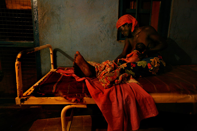 A mother breastfeeds her newborn infant after giving birth at the clinic in Wantugu.