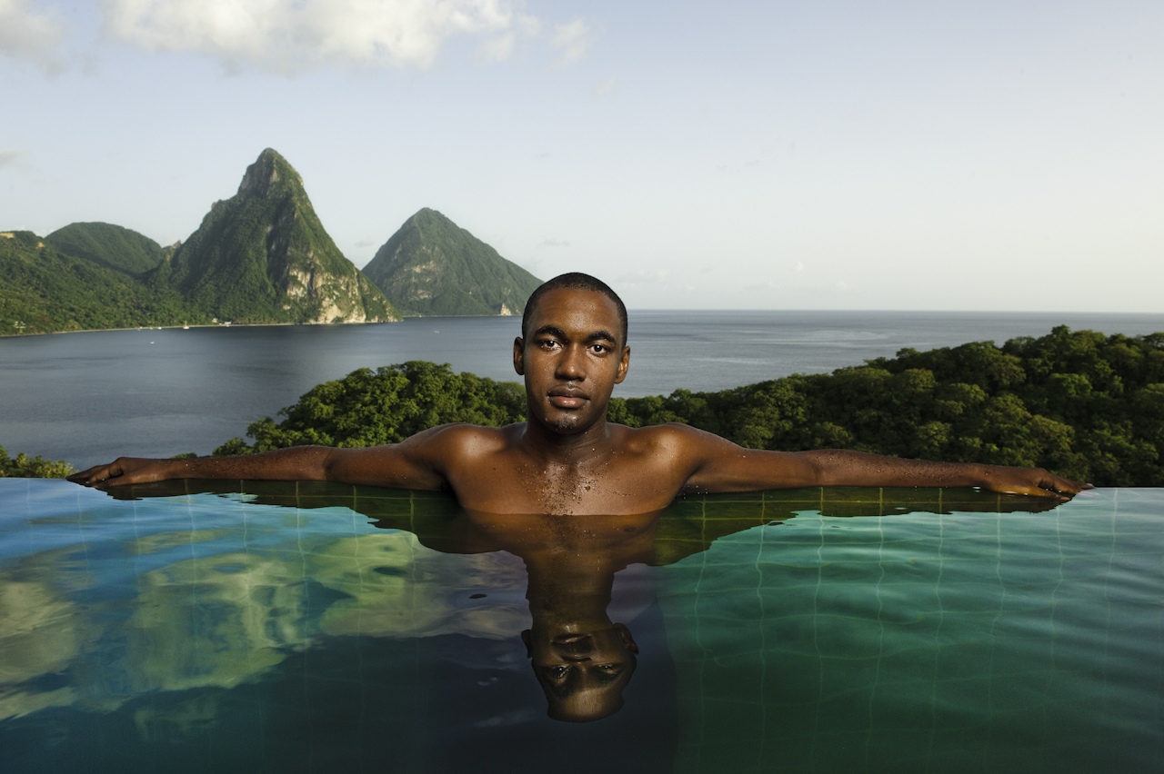 Man in infinity pool with Grand Pitons   On a shoot for Islands magazine at Jade Mountain Resort my room not only had an infinity pool but the lack of walls offered a magnificent view of the Grand Pitons. Oh, and a good looking guy to boot.