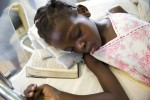 Injured girl in St. Damien's Hospital sleeping with a bible under her head