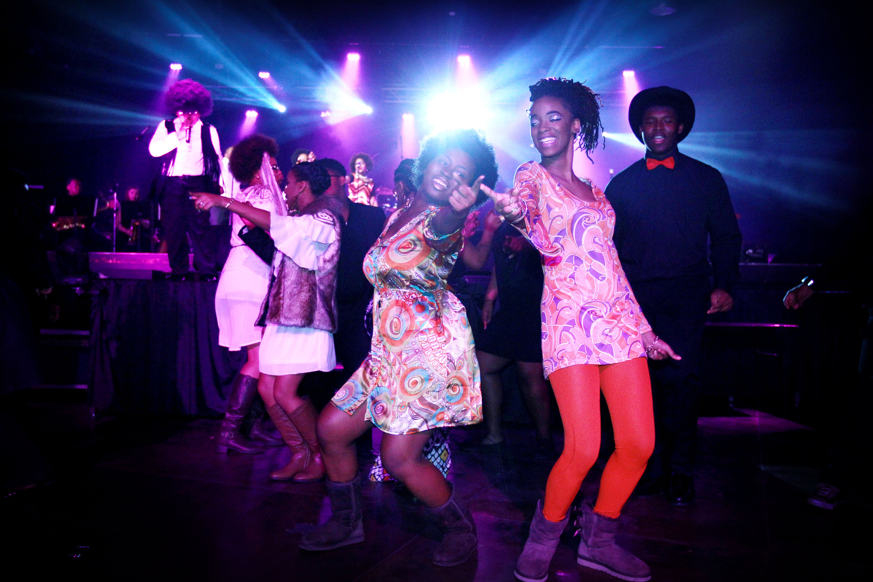 February 25, 2016 - Chantalia Wray, 14, (left) and Xia Gilbsy, 15, dance with other members of the Stax Music Academy during a performance of {quote}Peace, Love and Soulsville!: Memphis to Motown{quote} at Minglewood Hall in celebration of Black History Month on Thursday. Roughly 1000 students from area school attended the show that highlighted the history and hits of Motown and Stax. In addition to the free show for students, a public show was performed in the evening. The Stax Music Academy' will be holding auditions March 1-4. Visit staxmusicacademy.org for more information. (Mike Brown/The Commercial Appeal)