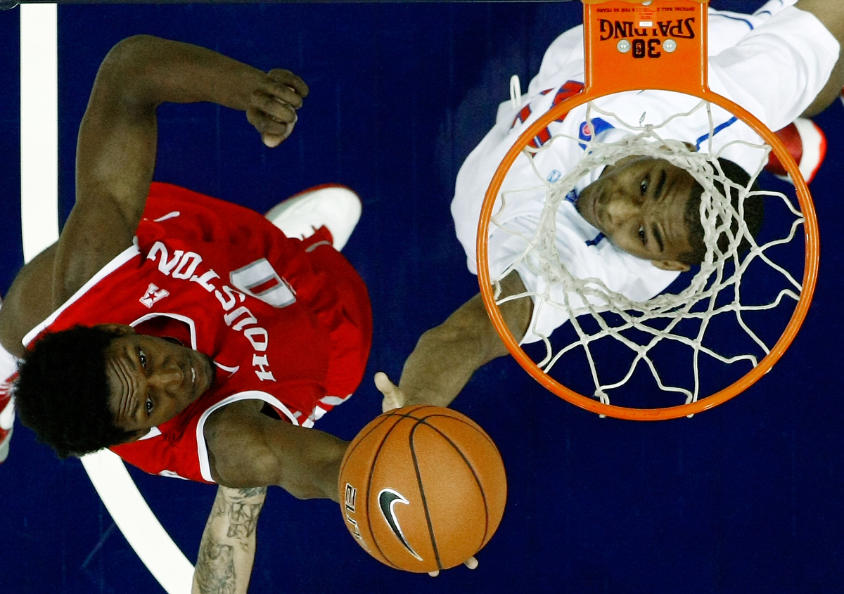 March 13, 2014 - Houston Cougars guard Danrad Knowles (L) battles SMU Mustangs forward Ben Moore (R) for a rebound during the quarterfinal round of the American Athletic Conference tournament at FedExForum. (Mike Brown/The Commercial Appeal)