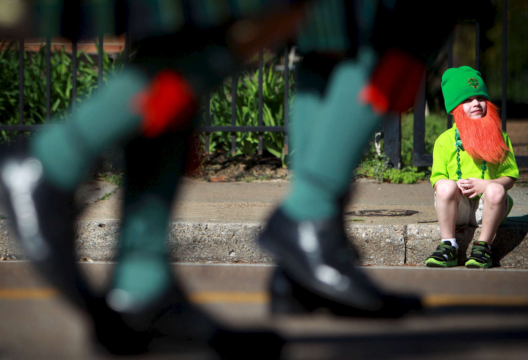 March 17, 2016 - Miles Fletcher, 5, watches a St. Patrick's Day parade march through Cooper-Young. The event marked the inaugural parade organized by the Memphis Irish Society which also celebrated the 100th anniversary of the 1916 Easter Rising which resulted in Irish independence. (Mike Brown/The Commercial Appeal)