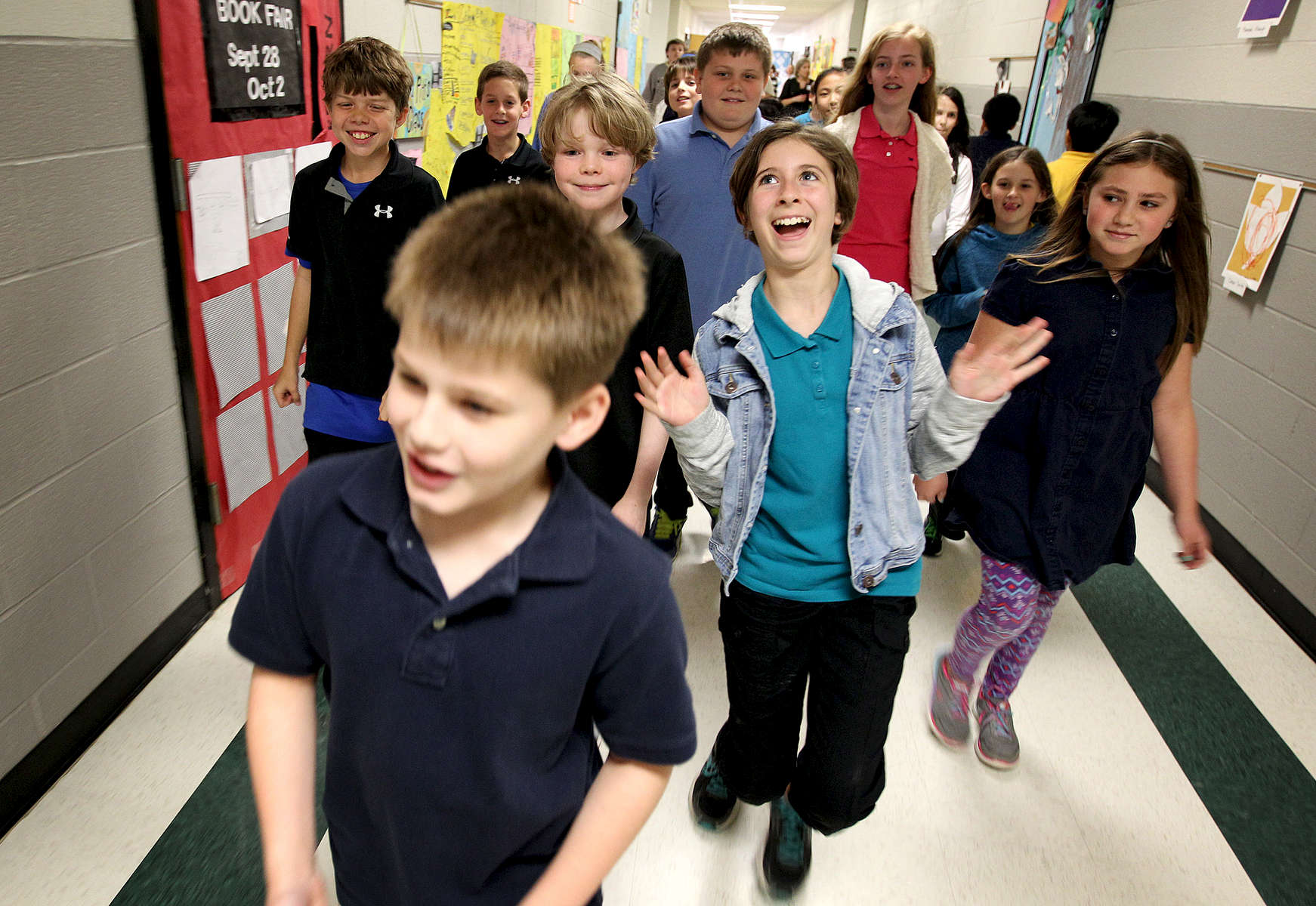April 7, 2016 - Lori Pound, 11, reacts with joy as she and the rest of her fifth grade class at Farmington Elementary during a scavenger hunt through the halls during Autism Awareness Week at the school. Pound has been diagnosed with Asperger syndrome, an autism spectrum disorder. The school has an above average number of student with autism and held an awareness week not only to inform students about the disorder but also to honor the students who have it. (Mike Brown/The Commercial Appeal)
