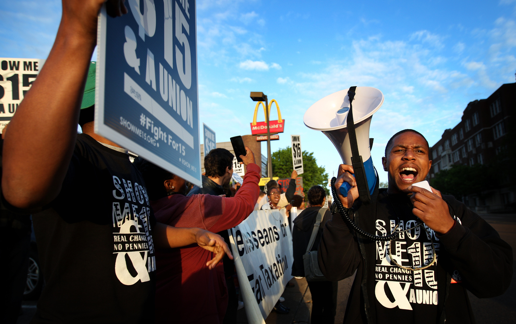 April 14, 2016 - Christopher Smith (right) leads chants during a protest outside the McDonald's on Union seeking higher wages for fast food workers. Some of the roughly 60 protesters gathered stormed the restaurant and chanted by the registers before briefly blocking traffic on Union. (Mike Brown/The Commercial Appeal)