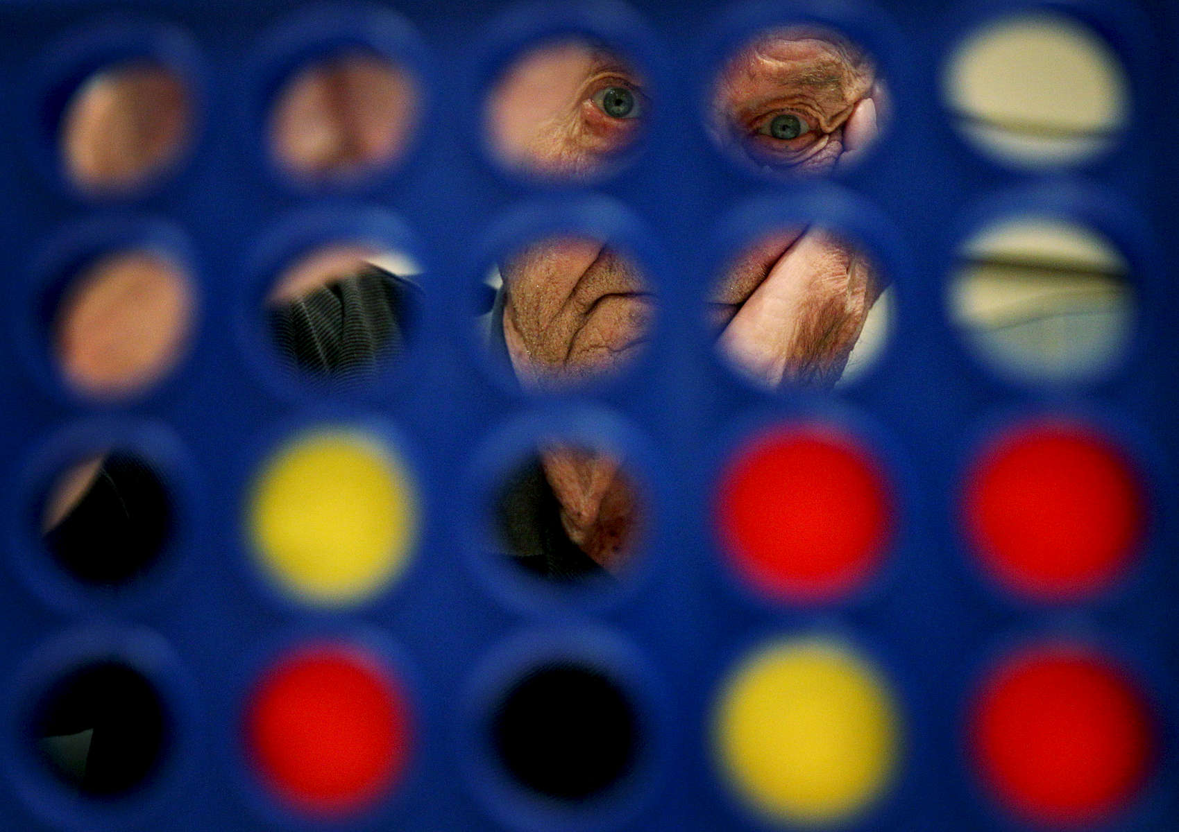 April 21, 2016 - Bill Schwan plays a game of Connect Four against Lauren Potter (not pictured) during the Creative Aging's fourth annual Senior Fun Day held at the Memphis Jewish Community Center. The event featured a variety of games and puzzles, ice cream, door prizes and free manicures. (Mike Brown/The Commercial Appeal)