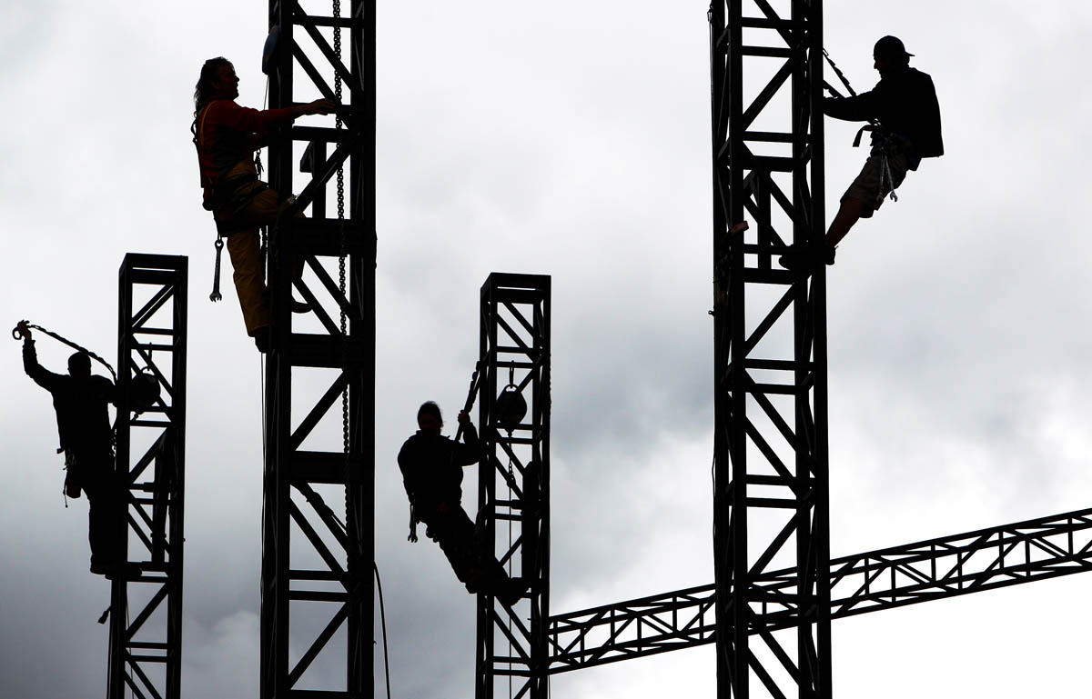 May 6, 2013 - (from left) Ronnie Harris, Carlin Tally, Austin Scott and David Morgan work together to remove the towers on one of the stages used during the Memphis in May Beale Street Music Festival to get preparations underway in the park for the 36th annual World Championship Barbecue Cooking Contest starting May 16. (Mike Brown/The Commercial Appeal)