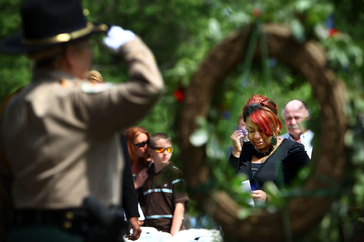 May 9, 2013 - Ivy Mason, a family member of slain Memphis Police officer Martoiya Lang, wipes away tears during the annual Fallen Heroes Memorial Service at Memorial Park Cemetery. The names of more than 150 first responders from the Memphis region that were killed in the line of duty were read aloud during the service attended by family members of those who gave the ultimate sacrifice. (Mike Brown/The Commercial Appeal)