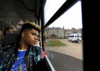 May 16, 2016 - Zearius Jenkins looks out the window of a bus as it departs from the St. George's Independent School Collierville campus filled with the senior class departing on their {quote}Trip to Nowhere{quote}. The field trip is a school tradition in which seniors are taken on an excursion by administrators during their final week of school to a secret location. The busses later pulled up to Autozone Park for the student to take in an afternoon ball game. (Mike Brown/The Commercial Appeal)