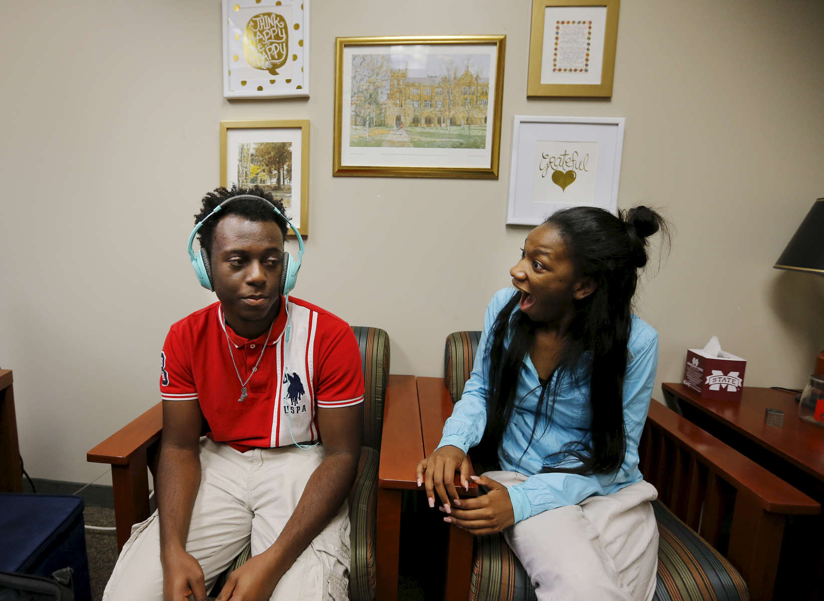 May 9, 2016 - Paige Madison (right) reacts as she learns that Donovan Borum was offered a full-ride scholarship to Wake Forest University. Neither Madison nor Borum are ending up at their first college of choice, Spelman College and Purdue University respectively, after other schools made finical offers they could not refuse. (Mike Brown/The Commercial Appeal)