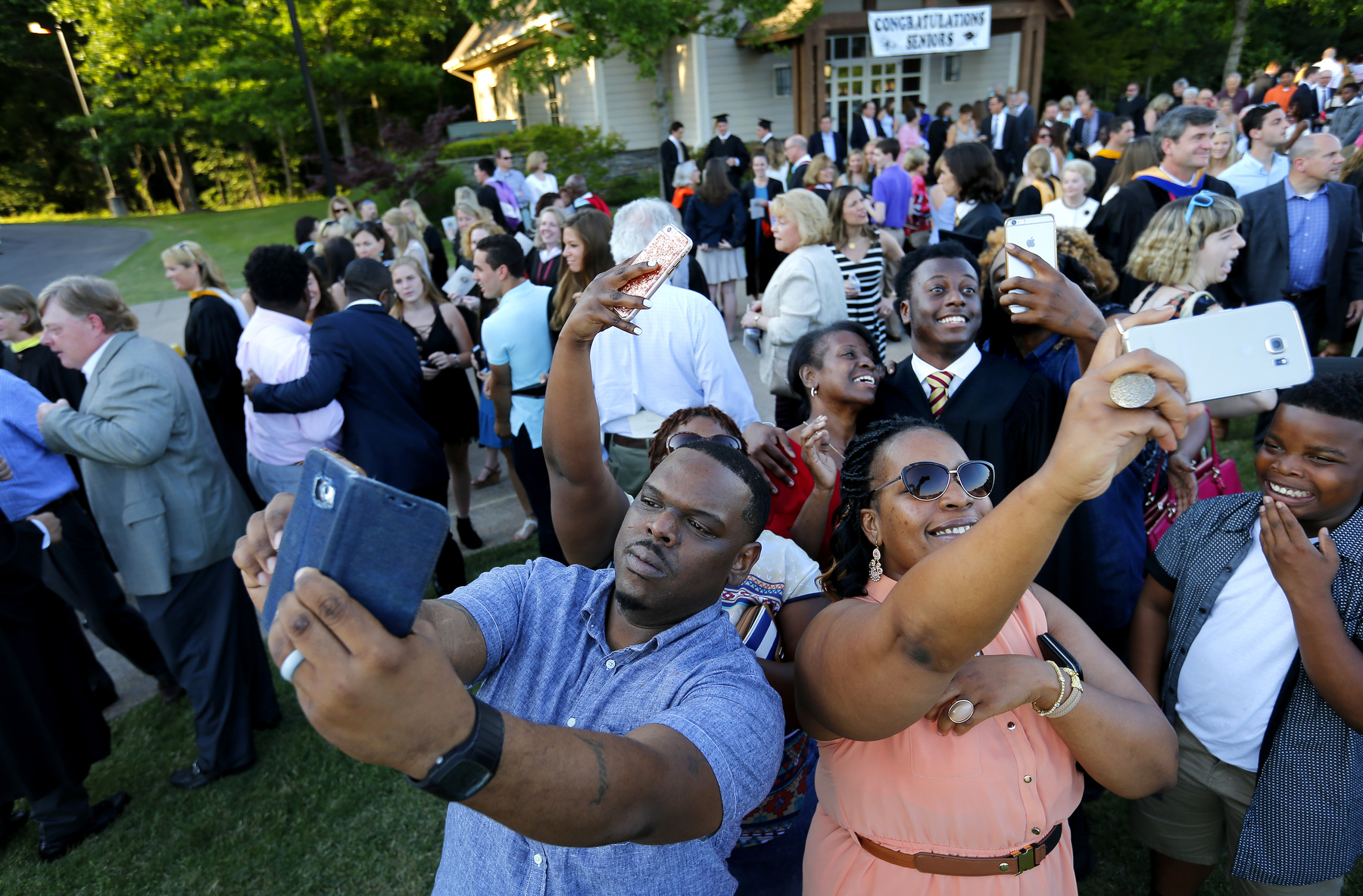 May 22, 2016 - Family members surround Donovan Borum to make selfies with their star moments after his graduation ceremony ended on the St. George's Collierville campus. With a full-ride scholarship to Wake Forest University worth more than $60,000 Borum will be the first member of his family to attend a four-year university. (Mike Brown/The Commercial Appeal)
