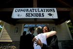 May 22, 2016 - Autumn Jones embraces St. George's former dean of students Jill Reilly shortly before graduation on the St. George's Collierville campus. Reilly, who spent 11 years at the school, began forging a relationship with the students  through regular visits to the Memphis campus beginning in third grade before they made the transition to Collierville in the sixth grade where she taught math. {quote}She was like one of our mothers.{quote} Jones said. {quote}She had high expectation and made sure we knew what we could do and were capable of.{quote} (Mike Brown/The Commercial Appeal)