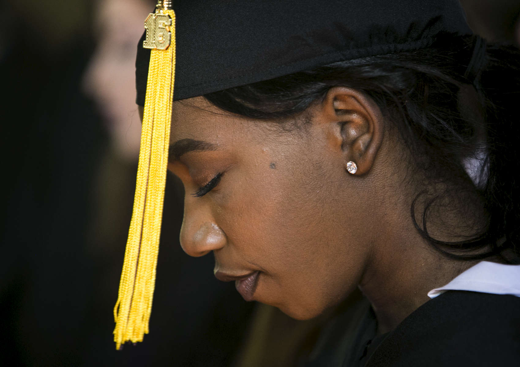 May 22, 2016 - Paige Madison closes her eyes and sits in quiet reflection during the final chapel the St. George's class of 2016 will have together before their commencement ceremony at the school. {quote}We viewed coming here differently than our peers here or outside of these walls. As far as black students going off to college, we've broken racial boundaries and geographical boundaries and socioeconomic boundaries, so now we are ready for what comes next.{quote} she said. (Mike Brown/The Commercial Appeal)