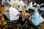 June 21, 2016 - Sue Burns, 87, is congratulated by Annie Green, 103, for her win after the two competed in the over-65 wheelchair race during the annual Nursing Home Olympics hosted by the Tennessee Health Care Association at Bellevue Baptist Church. Nineteen nursing home competed in five different events including darts, horse shoes, bean bag toss, basketball and wheelchair races broken into two age groups. (Mike Brown/The Commercial Appeal)