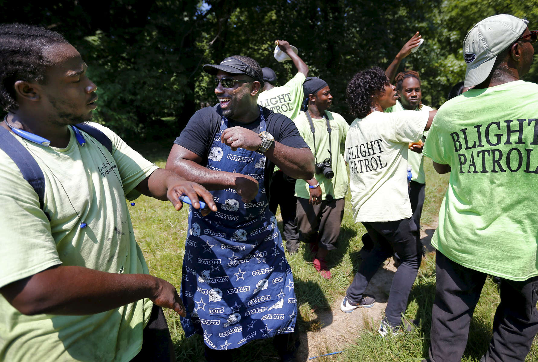 July 18, 2016 - DeAndre Brown (second from left) takes a break from the grill and dances with members of the LifeLine 2 Success Blight Control during a rally against violence down the street from where a 19-year-old was murdered Saturday night. Brown cooked burgers and hot dogs for area residents, held a prayer with police officers to spread the message that violence is not acceptable. (Mike Brown/The Commercial Appeal)