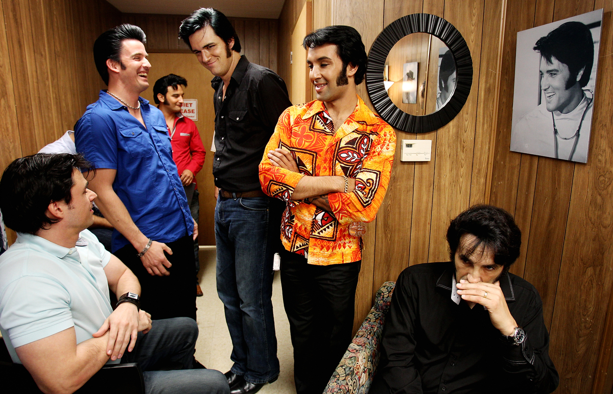 August 13, 2013 - Diogo Leichtweis (from left), from Brazil, Rob Ely, from Oakdale, Ca., Gordon Elvis, from England, Adam Fitzpatrick, from British Columbia, Eli Williams also from British Columbia, and Jay Zanier, from Ontario, joke with each other as they wait for their turn to perform as 25 Elvis tribute artists participate in a showcase at Graceland for the Ultimate Elvis Tribute Artist Contest which begins with the semifinal round at the Cannon Center on Wednesday and concludes with the final round on Saturday night. Additional Elvis Week events continue through Saturday including the annual candle light vigil outside the gates of Graceland on Thursday and performers on multiple stages daily at Graceland. (Mike Brown/The Commercial Appeal)