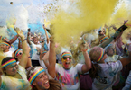 September 7, 2014 - Participants revel in the colored powered being  they are throwing on each other after completing The Color Run at Tiger Lane on Sunday. (Mike Brown/The Commercial Appeal)