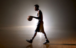 September 28, 2015 - Mike Conley walks across the practice court for a video shoot during the Memphis Grizzlies media day at FedExForum. (Mike Brown/The Commercial Appeal)