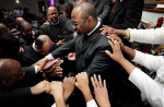November 4, 2012 - Members of the congregation at Greater Community Temple pray over their pastor Bishop Brandon B. Porter during the 10 a.m. Sunday service at the church's Winchester location. Porter is seeking election to the Church of God in Christ general board during the annual convocation in St. Louis on November 13. (Mike Brown/The Commercial Appeal)