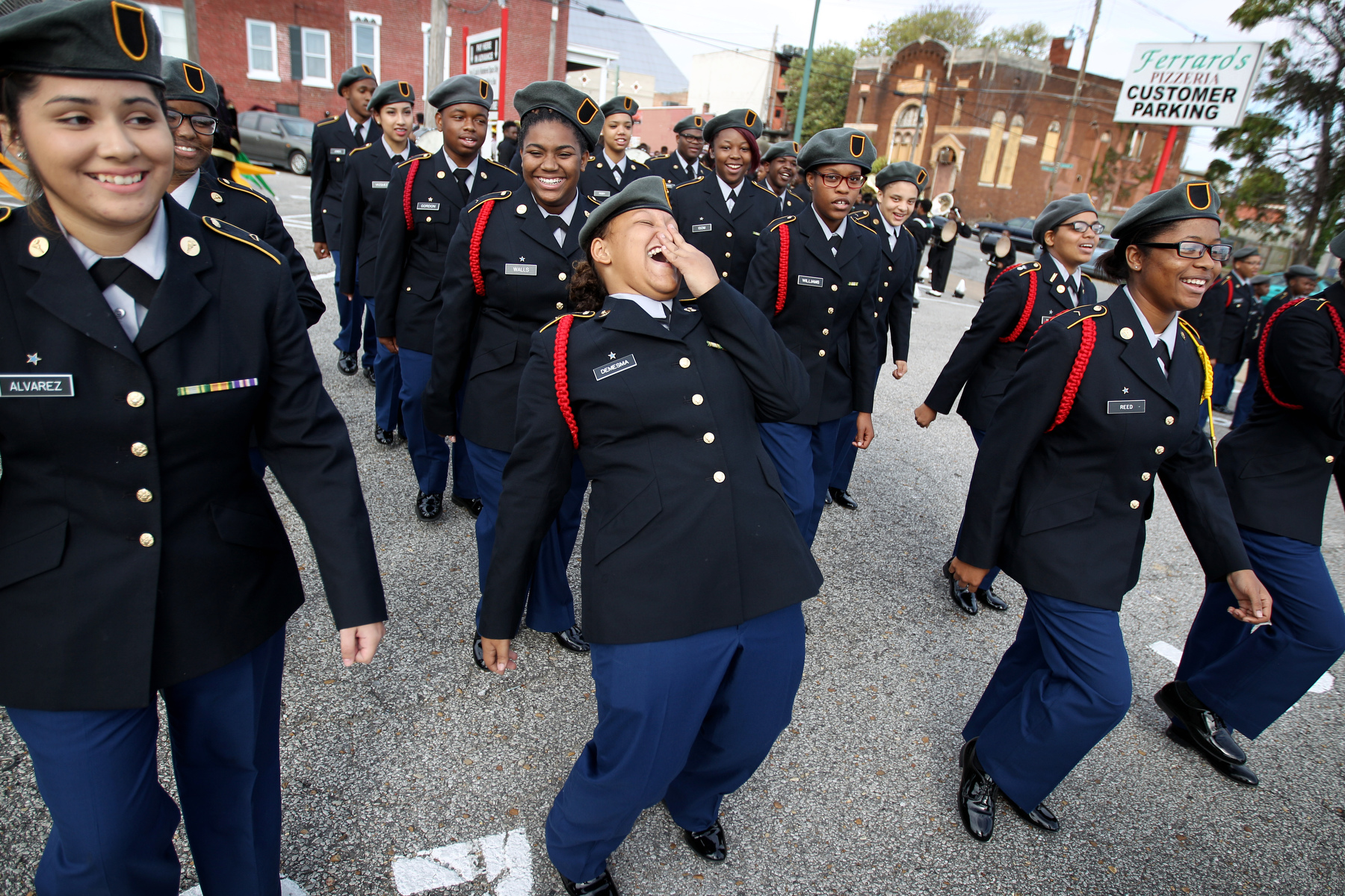 November 11, 2015 - Overton High School sophomore Keona Demesma, 15, laughs while the school's ROTC lines up and practicing before the start of the annual Veteran's Day parade through downtown Memphis. (Mike Brown/The Commercial Appeal)