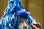 November 22, 2015 - Meagan Cross gets into character as a female version of Hades from Disney's Hercules with help from A.G. Howard, from Howardart Studios, during the final day of the sixth annual Memphis Comic and Fantasy Convention at Hilton Memphis. (Mike Brown/The Commercial Appeal)