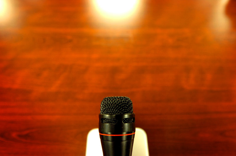 The microphone that will be used by detainees sits in the silence of the Military Commissions courtroom on the United States Naval Station in Guantanamo Bay, Cuba.(© Mike Brown)