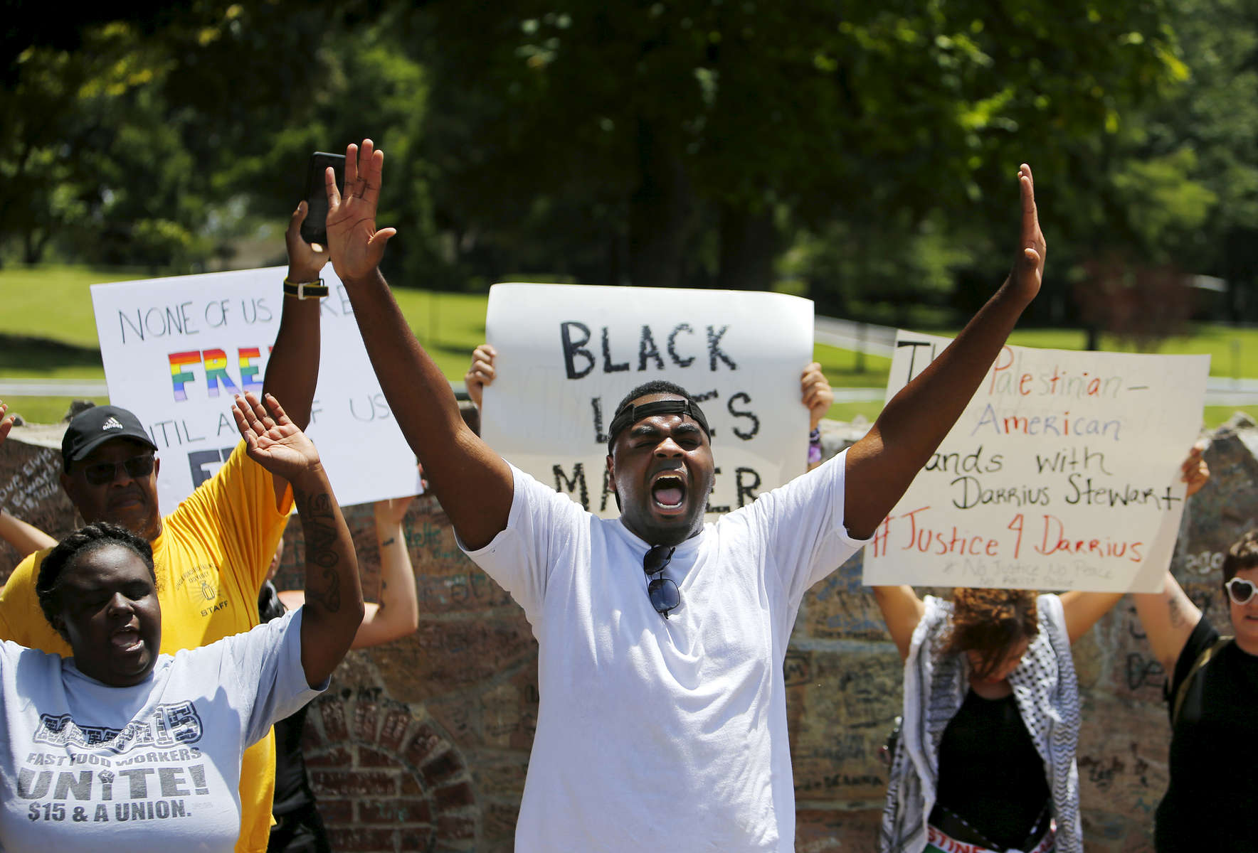 July 12, 2016 - Antonio Cathey (center) and others with the Black Lives Matter movement chant during a rally outside Graceland on Elvis Presley Blvd Tuesday afternoon. Roughly 60-70 people gathered peacefully outside the gates of the famous tourist destination. (Mike Brown/The Commercial Appeal)