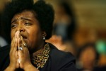 Dujuna Chambers, of Memphis, prays during the Prayer of Intercession and Supplication at Mason Temple Monday morning. The event marked the unofficial kick-off to the Centennial Holy Convocation.(Mike Brown/ Memphis Commercial Appeal)
