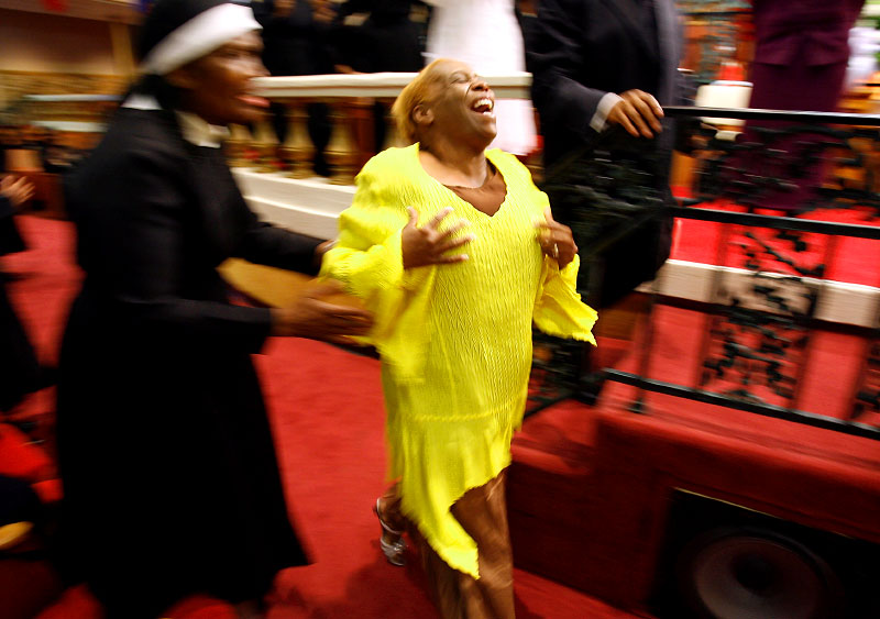 Vicki Williams, of Denver, CO, dances through the aisle in Mason Temple after testifying about receiving a helping hand to afford her pilgrimage to the 100th annual Holy Convocation. She also spoke about a phone call she received after her arrival in Memphis from her son, whom she never thought she would see again, saying he had been released from prison despite a life sentence. Many filling the historic church, named after COGIC founder Mason Temple, got on stage and testified of miracles in their lives since arriving in Memphis for the convocation.(Mike Brown/ Memphis Commercial Appeal)
