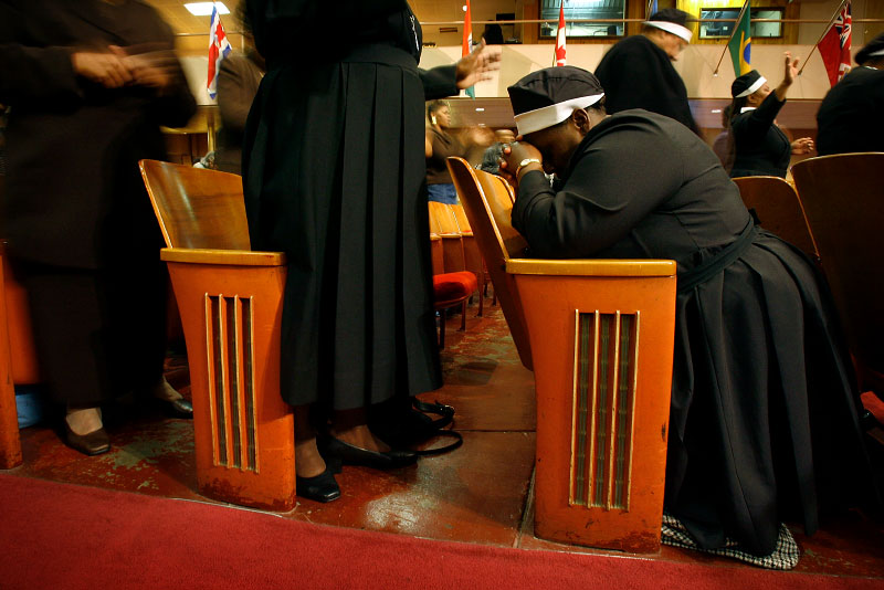 Evangelist Frederique Curtis, from Chicago, kneels to pray in her seat during the Prayer of Intercession and Supplication at Mason Temple Monday morning.(Mike Brown/ Memphis Commercial Appeal)