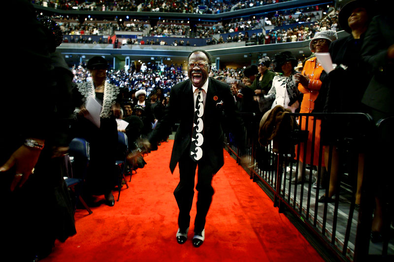Elder Cal H.P. Merrell, from Atlanta, yells out while dancing with a tambourine during the Convocation Official Day Service at FedExForum. Saints from all over the world filled the arena to hear the sermon delivered by Presiding Bishop Charles E. Blake.