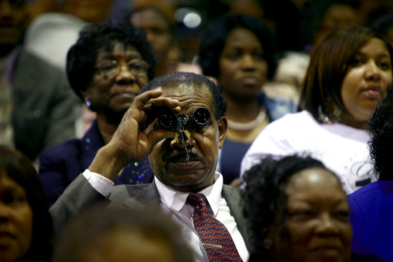 David Gallo, of Covington, Louisiana, tries to get a closer view of the stage from the back of the Cook Convention Center during the 100th annual COGIC Holy Convocation.(Mike Brown/ Memphis Commercial Appeal)