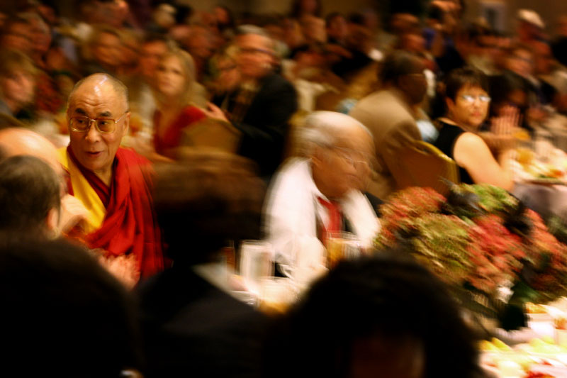 The Dalai Lama is greeted by guests of a luncheon in his honor at the Peabody Hotel in Memphis, Tenn. on Wednesday, September 23, 2009. The Dalai Lama was in Memphis to be honored with the 2009 International Freedom Award from the National Civil Rights Museum. His Holiness showed appreciation by donating the $50,000 honorarium back to the museum.