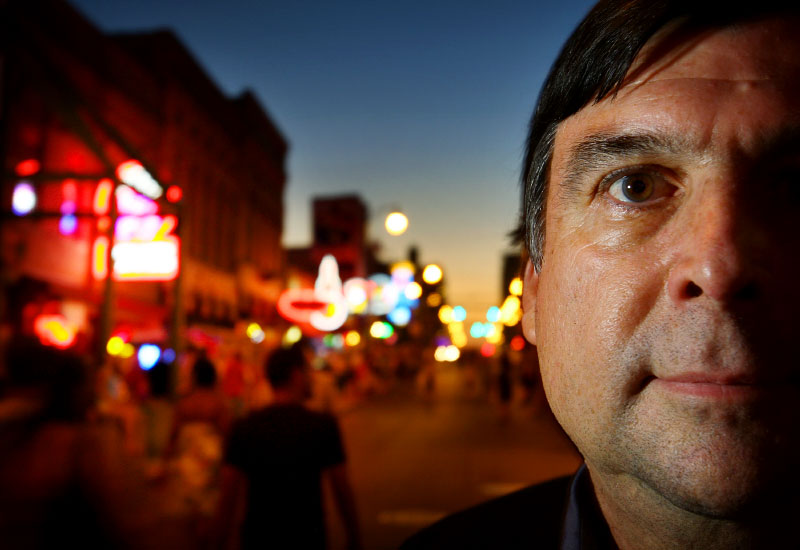 "Dean Deyo, president of the Memphis Music Foundation, stands on Beale Street. ""What we've tried to do is be very grassroots-oriented, and give artists those development type things,"" says Deyo. ""If you're an independent artist or songwriter or someone who wants to be in the industry there are these barriers - whether its finances or education or just knowing what to do. We want to eliminate the barriers standing in their way and give them what they need to move ahead."""