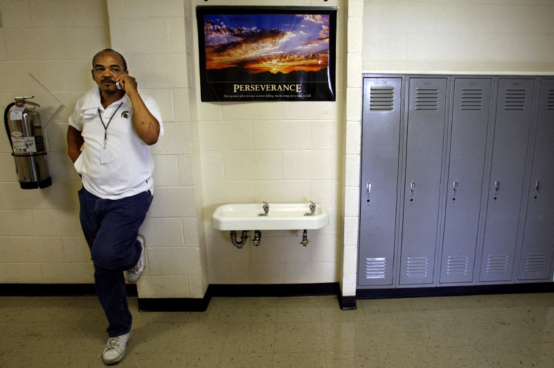 {quote}Uncle{quote} Joe Hunter talks on his cell phone in a Frayser High School hallway. Hunter, a former gangster turned preacher, volunteers as a mentor at several North Memphis schools. He also reaches out to gang members in his after-school program. {quote}That guy who just finished smoking a blunt and has a gun on him, I still hug him.{quote} he said. {quote}And when that time of desperation comes, you know who they'll call? Uncle Joe.{quote}(Mike Brown/ Memphis Commercial Appeal)