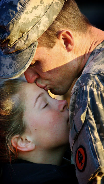 Frank Cheatham kisses his daughter Madison, 13, goodbye outside the James A. Gardner Armory in Dyersburg as he prepares to deploy to Iraq with the Tennessee Army National Guard's 168th Military Police Battalion on his 35th birthday. Mike Brown / Memphis Commercial Appeal