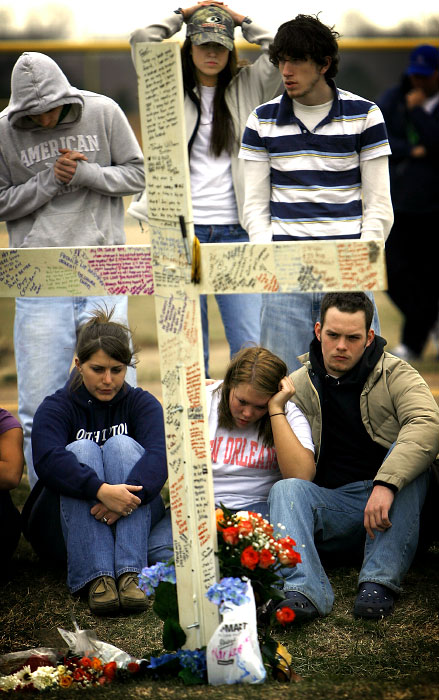 A group of Millington Central High School students sit in silence in front of a memorial erected for senior Jacob {quote}Jake{quote} C. Smith who died Monday morning from injuries received in a single car accident Sunday night. Smith's 1999 Mitsubishi Eclipse ran off the road on Shelby Road near Epperson Mill Road in Millington crashing through a utility pole and fence before landing on it's roof. Smith is the second senior from the school to die in an auto accident in the past two and a half months. (Mike Brown/Memphis Commercial Appeal)