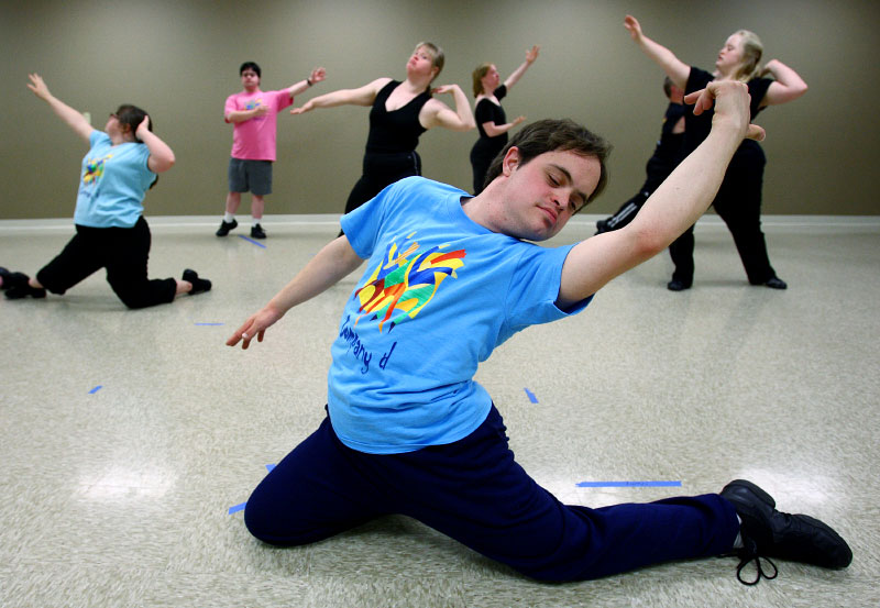 Kenny Thielemier, 23, closes a dance with grace during practices with Company d, a performing arts troupe for individuals with Down Syndrome. The group performs around town regularly and has even performed at an official off-Broadway venue in New York City.