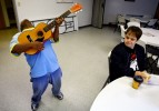 Kenny Thielemier gets a morning serenade from classmate Danny Munson, 20, as he eats his breakfast at the Good Life Center, a nonprofit day program operated by the West Tennessee Family Solutions. At the program Kenny learns skills that can be applied to his janitorial job along with performing community services.