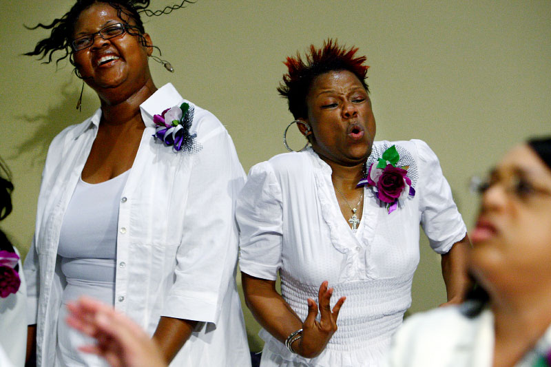 FEELING THE SPIRIT:At times you can feel the floor shaking beneath your feet when the Greater Community Temple Choir performs during a Sunday service in East Memphis, where member Shawana Brasswell(right) feels the spirit during worship. The influence of gospel sounds and styles permeates all genres of music in Memphis.