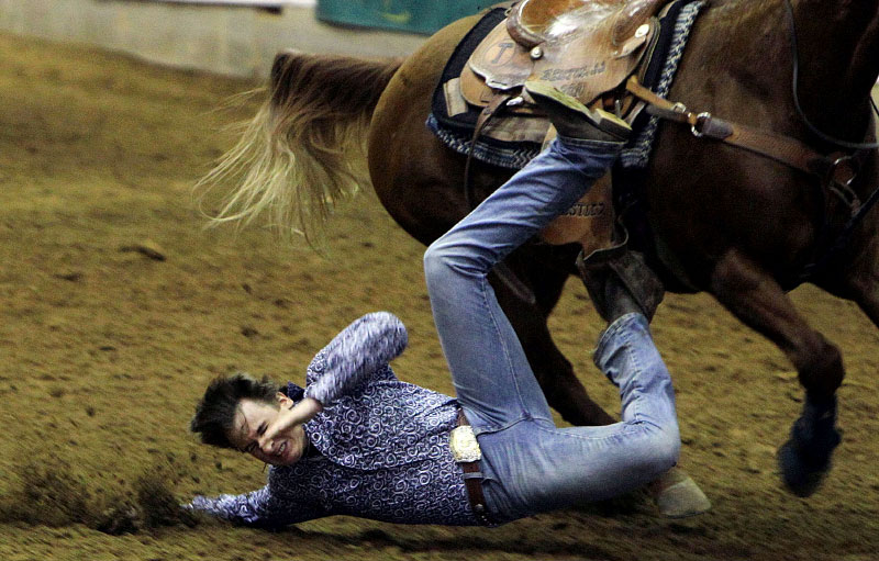 March 11, 2012 - Seth Mallett, of Greenbier, Ark., collides with the ground while competing in the steer wrestling portion of the Tennessee High School Rodeo Association's Tennessee Challenge at Showplace Arena on Sunday. (Mike Brown/The Commercial Appeal)