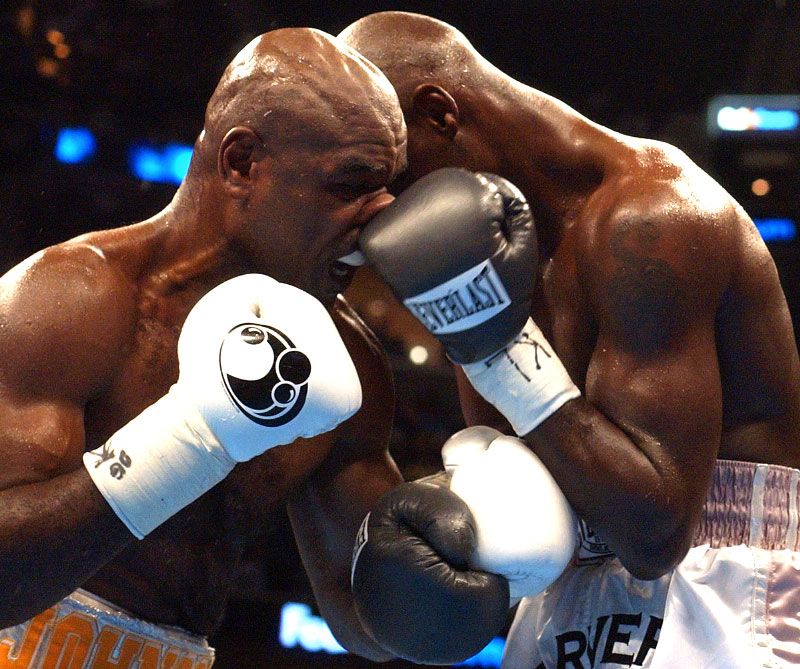 Glen Johnson (Left) gets hit in the nose by Antonio Tarver during their title fight at the FedEx Forum. Tarver defeated Johnson by a unanimous decision to win the Light Heavyweight World Championship Title.(Mike Brown)