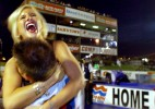 Hillary Burke, daughter of Rod Fullers sponsor David Powers, celebrates after Rod Fuller  (not pictured) captured his first Top Fuel victory Sunday night at Memphis Motorsports Park.(Mike Brown)