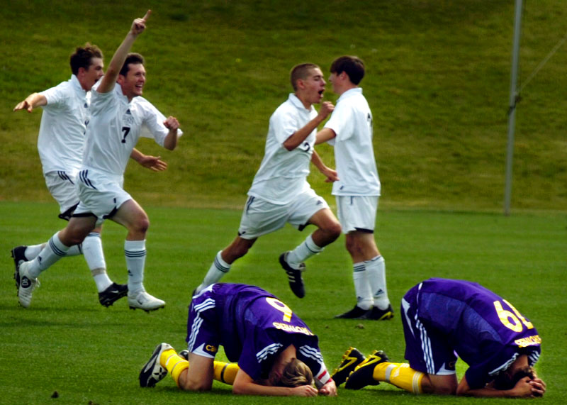 Christian Brothers High School soccer players Philip Ramsey (Left) and Matt Pahde are overwhelmed by their 3-2 loss to Father Ryan in the 2005 TSSAA Division II State Soccer Championship game.(Mike Brown)