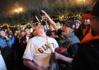 James Choi ( with bottle) celebrates in San Francisco after the Giants won the World Series on October 28, 2012.