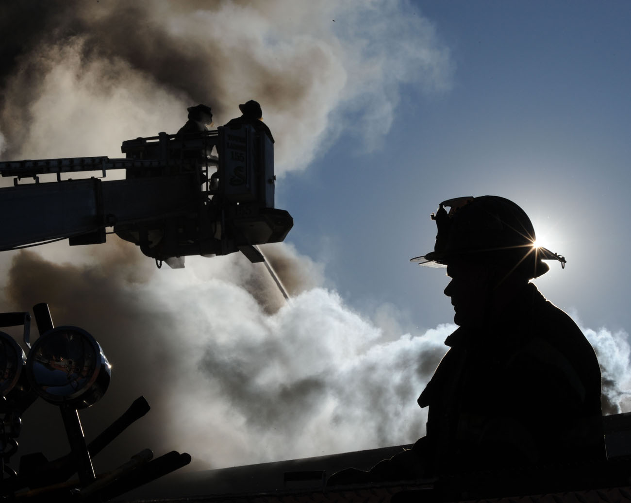 Firefighter Tom Ryan and other members of Ladder 155 are seen at a third alarm fire that broke out at 138-10 Farmers Blvd. in Queens on September 19, 2009.
