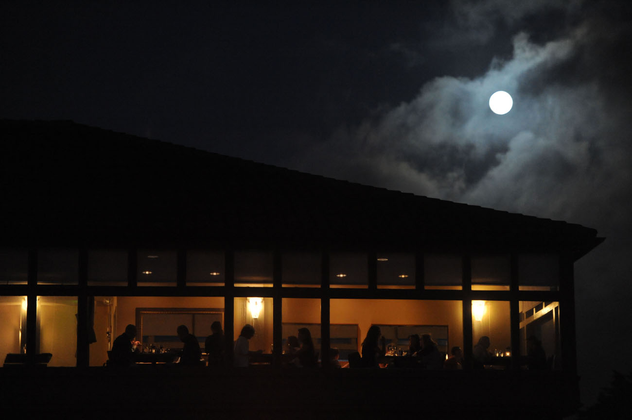 Diners are seen at the Beach Chalet underneath the full harvest moon on September 22, 2010.
