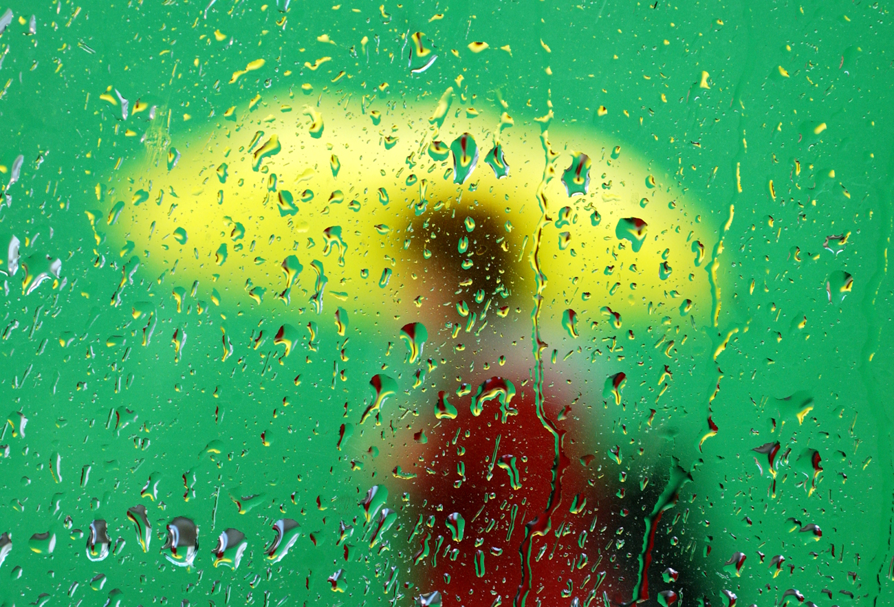 A pedestrian is seen through a car window on Northern Blvd. in Queens, New York on October 12, 2005.