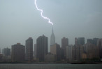 Lightning strikes the antenna on the Empire State Building in Manhattan, during an afternoon thunderstorm, as seen from Gantry State Plaza Park in Long Island City, NY on May 16, 2007. The building, which was designed to serve as a lightning rod for the surrounding midtown area, gets jolted about 100 times a year.
