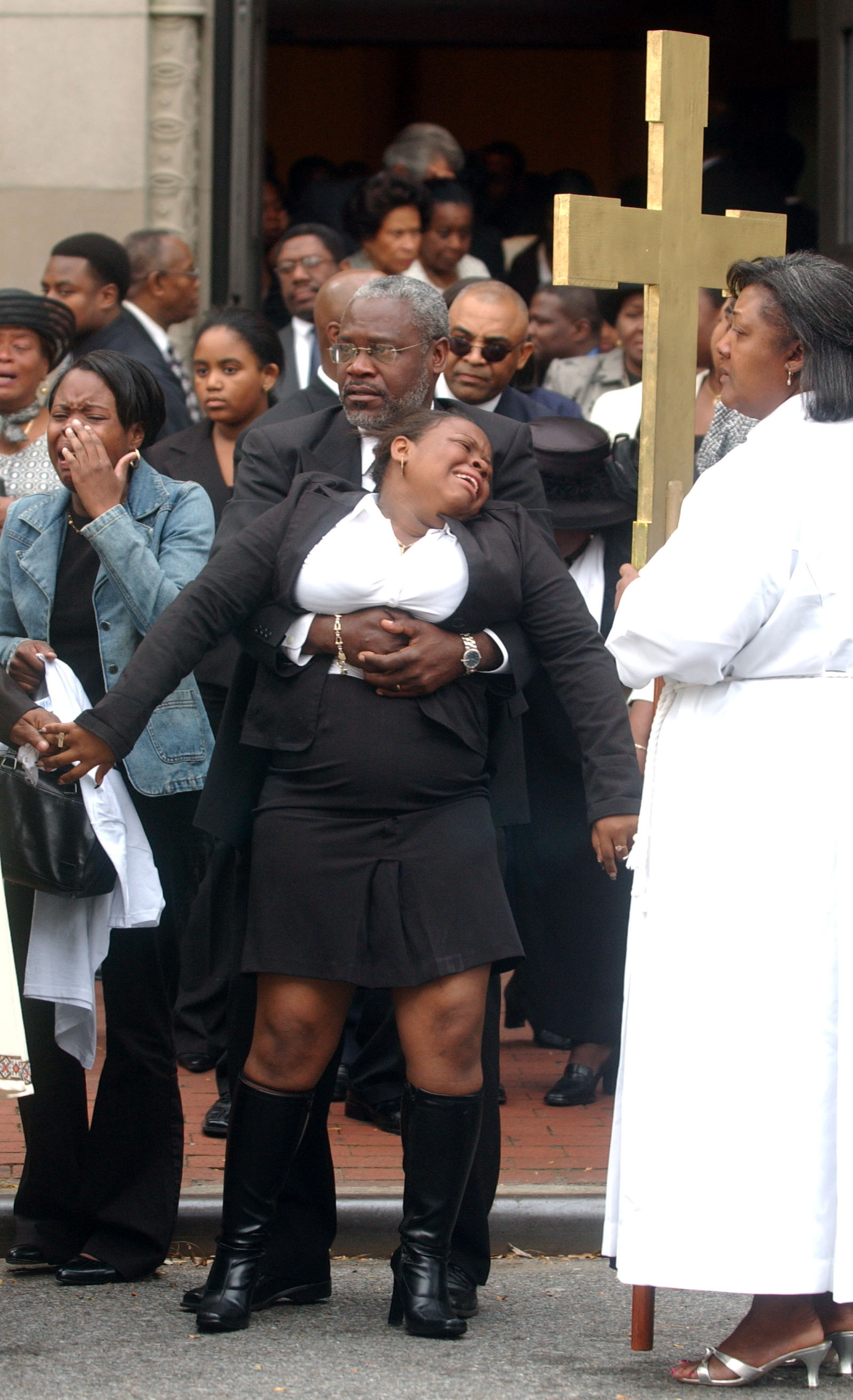 Loved ones of Guy Victor mourn his death at his funeral at St. Therese of Lisieux Church in Brooklyn on Oct. 1, 2004. Victor was killed in an auto accident the week before.